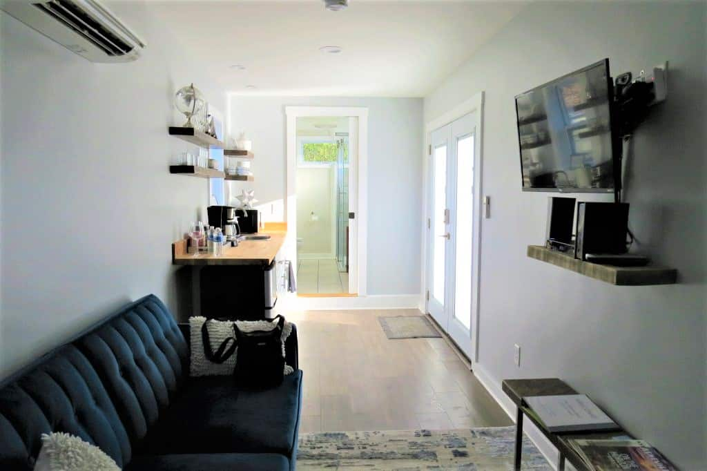 View from the bed into the kitchen and bathroom of the renovated storage container