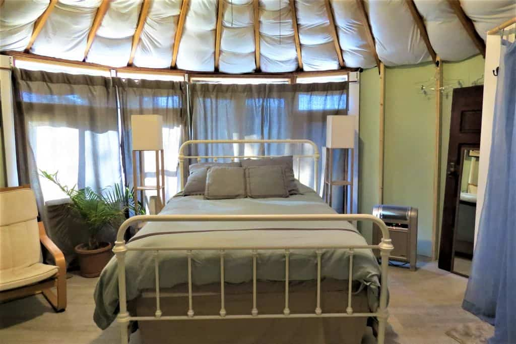 The windows behind the bed in the Yurt had views of the mountains